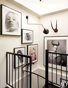 A Serge Mouille sconce and a set of trophy antlers join photographs by David Sims, Karlheinz Weinberger, and Janette Beckman in the stairwell—a sly nod to the traditional arrangements of English portrait galleries.