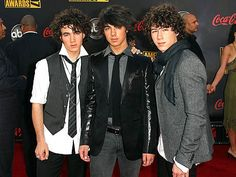 Musicians Nick Jonas, Joe Jonas, and Kevin Jonas from the Jonas Brothers arrive at the 2007 American Music Awards held at the Nokia Theatre L.A. LIVE on November 18, 2007 in Los Angeles, California.