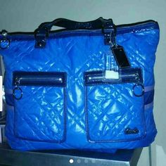 """NEW Authentic Coach Poppy Ski Bunny Tote New without tags,never used and flawless! Authentic Coach Poppy Ski Bunny Quilted Nylon tote in Blue. Includes two Coach hangtags, one of which is the Coach """"Snow Globe"""" hangtag.. super cute! Coach Bags Totes"""