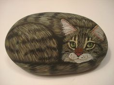 Brown Tabby Cat hand painted on a stone - pet rock by Ann Kelly #Realism