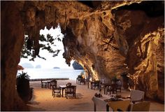 Rayavadee Resort in Thailand. Guests can enjoy the surreal beaches and dine in a glowing nook inside one of the many natural caves on the island. White sandy beaches and crystalline water are only steps away from the resort's master suites. The unique ambiance and overwhelming beauty of the Rayavadee make it an idyllic, world class tropical island retreat.