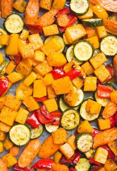 Roasted carrots, butternut squash, peppers and courgettes (zucchinis), served with quinoa and pesto - a vegan and gluten free recipe