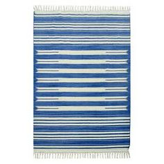 Add a handsome design accent that will bring a fresh burst of energy to any space it rests in with the Flatweave Striped Area Rug. Featuring an alternating pattern of cream and colored stripes, this bold area rug has just the right kind of timeless design that will blend in beautifully with almost any decor. Perfect for any living space, this 100% wool rug is the essence of both functionality and style.