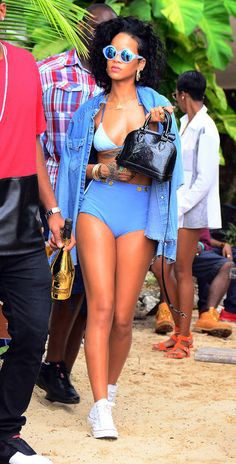 Vacation Outfit Idea: Go Retro in Blue, à la Rihanna Nobody does vacation style like Rihanna. This funky blue look (worn while catching rays in her native Barbados) is easy to copy with pieces you probably already have in your closet.