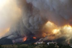 The Waldo Canyon wildfire burns in Colorado Springs, June 26, 2012. (Gaylon Wampler/AP)