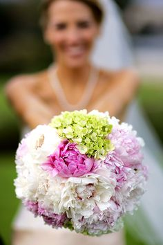Lovely bridal bouquet of white and pink peonies and light green hydrangea.