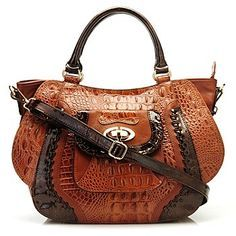 Madi Claire handbags.  I love the whole line.  I have this one in emerald green and dark brown trim.  Very expensive looking at about half the price of other leather handbags.