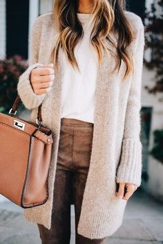 Cozy beige cardigan over white blouse and tan leather pants.