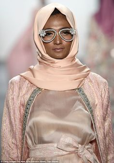 Anniesa Hasibuan, 30, made NYFW history when she presented her collection in which all the models wore headscarves.  The Indonesian designer presented her show in Manhattan on Monday.