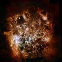 This image shows the Large Magellanic Cloud galaxy in infrared light as seen by ESA's Herschel Space Observatory and NASA's Spitzer Space Telescope. The brightest center-left region is called 30 Doradus, or the Tarantula Nebula. Herschel, Carl Sagan Cosmos, Spitzer Space Telescope, Infrared Telescope, Astronomy Pictures, Spiral Galaxy, Star Formation, Space Photos, Space Images
