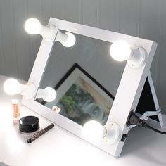 Vanity Mirror with Light Hollywood Makeup Mirror  Aluminum Frame, Wooden Base  Front on/off rotating dimmer switch, US Plug  FREE LED globules  Exquisitely configuration, Wall hung or append to stand  Takes into account Easier Makeup Application Or Any Of Your Grooming Needs  Bundle: 1x Hollywood cosmetics lit mirror, 110V LED knobs You can look here and buy.
