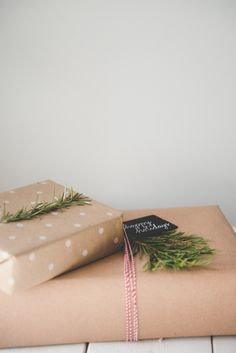 Christmas wrapping with kraft paper and rosemary or pine