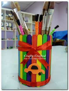 popsicle sticks around tin can makes for a cute pencil or paintbrush holder. Cute in a classroom!