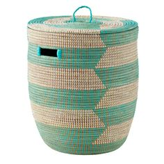 Shop Charming Hamper (Aqua Herringbone).  While these colorful baskets are in fact charming, they're also reminiscent of the classic baskets used by traditional snake charmers.  But don't worry, there's nothing inside them.