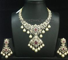 Diamond Necklace Floral clasps placed huge diamond short necklace with two step designer pendant embellished in the center. Studded with round changeable r. - Latest Collection of best Indian Jewellery Designs. Black Diamond Earrings, Diamond Necklace Set, Dimond Necklace, Silver Earrings, Garnet Necklace, Emerald Diamond, Ruby Jewelry, Silver Jewelry, Fine Jewelry