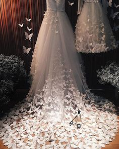 A #weddingdress fit for a fairy princess! // #SperanzaCouture #weddinggown with a cascading tulle train embroidered with flowers and butterflies. {Instagram: theweddingscoop}