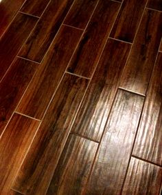 Tile that looks like hardwood flooring~ add the warmth of the look of wood with a practical floor choice that will hold up to scratching (aka dogs :)
