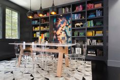Outstanding Mango Wood Coffee Table in Contemporary Dining Room with Color Coordinated Bookshelf Next to Clear Dining Chairs Alongside with Built in Bookshelf