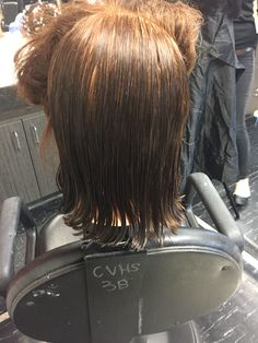 Giving Rolanda a hair cut!