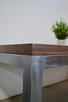 Walnut tabletop on brushed steel parsons base