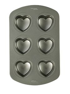 Nonstick Mini Heart Cupcake Pan Make heart-shaped cupcakes for Valentine's Day! This Nonstick Mini Heart Cupcake Pan measures high x wide and makes Mini Cake Pans, Cupcake Pans, Mini Cakes, Cake Decorating Supplies, Baking Supplies, Baking Tools, Baking Supply Store, Heart Shaped Cakes, Heart Cupcakes
