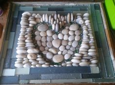 Long Island beach rocks with glass boarder tile and glass pebbles.