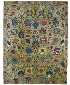 A 'Petag' Tabriz Carpet, Northwest Persia, woven with the Petag mark in the lower right corner, the design based on 16th century Safavid 'Vase' carpets, on an unusual green ground Approximately 398 by 312cm; 13ft., 10ft. 3in. circa 1920