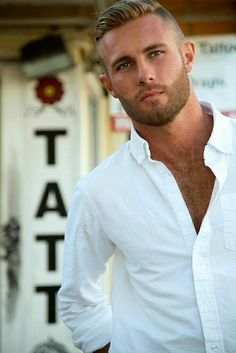 Stunning look, facial hair, pristine white shirt, hair is immaculate, this is a good looking guy