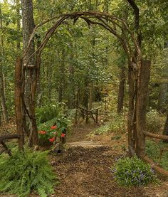 This award winning outdoor space was created by recycling fallen trees, recycled. This award winning outdoor space was created by recycling fallen trees, recycled concrete well cove Forest Garden, Woodland Garden, Garden In The Woods, Forest Home, Forest Path, Garden Arbor, Garden Gates, Garden Trellis, Garden Archway