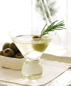 Rosemary Martini  16 pimento-stuffed olives, in brine  1 tablespoon chopped fresh rosemary  1 (6-inch) sprig fresh rosemary  1 bottle (750 ml) gin  1/4 cup dry vermouth