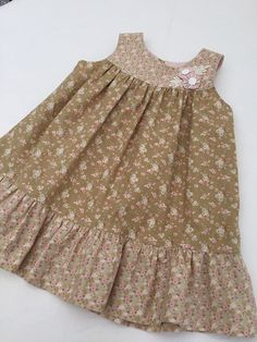 Flower dress for a 1 year old girl. Back closeure/ two