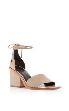 Cherished for her sleek, modern staples, for Resort 2016 Amy Smilovic fuses her effortlessly luxe separates with athletic details and decorative touches inspired by biology. Crafted in nude nappa leather with ankle cords and a chunky heel, these Tibi Clark sandals prove themselves a sophisticated essential for the modern wardrobe.