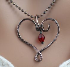 Ruby Crystal in Hand Forged Heart in Copper. $22.50, via Etsy.