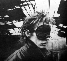 Blixa Bargeld with mask, Berlin 1983. Portrait by Anton Corbijn.