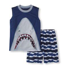 He can sink his teeth into a  good night's sleep with this shark bite PJ set!
