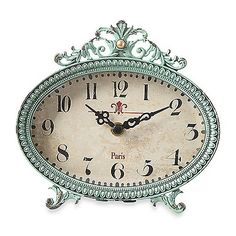 Add a chic, old-world French look to your home with this pewter tabletop clock. It has beautiful detailing on the rim, a pretty scroll topper, and gracefully curved feet.