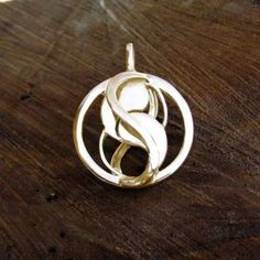 Entangled Pendant Gold Designed as a sacred geometry symbol of unity