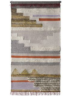 Handwoven textile wall hangings celebrate the art and beauty of handcrafted artisan goods. Woven wool with cotton and metallic thread accents showcases knubby textures, weave patterns, and fringe deta