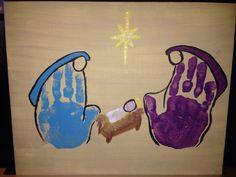 Presépio - com impressão de mãos. Mary, Joseph and baby Jesus handprint artwork.