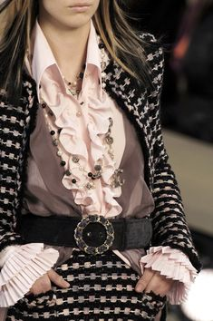 Chanel. note the top layers under the belt