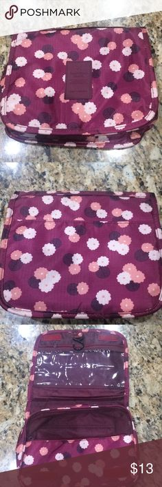 "Travel organizer Travel organizer. Floral pattern. One clear pocket on top & larger zip pocket at bottom, slip pockets inside. Measures 9"" wide, 7.5"" tall and can open to 3.5"" in depth. Has a hook inside so it can be hung up. Velcro closer. Has been used a couple times but still good condition. Comes w/ 14 various samples inside and a pack of 3 girly emery boards. :) great for travel! Samples include: Chanel, YSL, Estée Lauder, Too faced, Smashbox & more. Will also include Ulta bath fizz…"