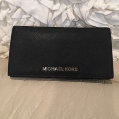 Like new Michael Kors Black wallet w/silver I have a beautiful flawless Michael Kors black wallet with silver hardware.  Extremely hard to find.  Authentic and well taken care off Michael Kors Bags Wallets