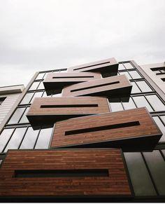 Building Facade. Framed glass. Wood facade.