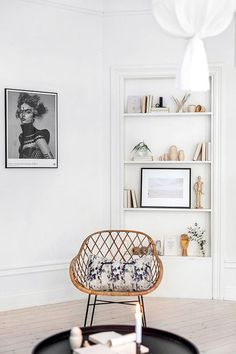 rattan chair with throw pillow via planete deco. / sfgirlbybay
