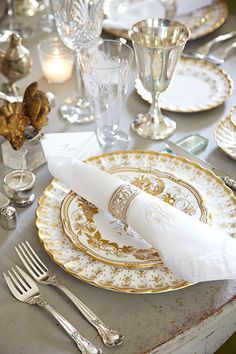 """Spode china in """"Fleur de Lys"""" mixes beautifully with Gorham crystal and antique Waterford goblets inherited from homeowner Katie Reynolds's ..."""