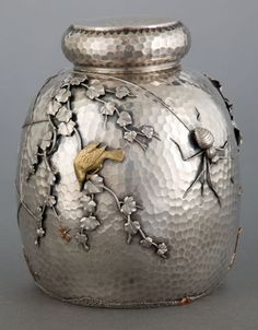 Gorham hand-hammered sterling and mixed-metal tea caddy with applied spider and web, bird on branch, and branch motif, Providence, (Heritage Auctions)(a) Tea Canisters, Tea Tins, Art Nouveau, Vintage Silver, Antique Silver, Gorham Silver, Bird On Branch, Antique Boxes, Tea Caddy