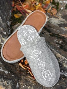 Finnish design.   Tossutellen products have been made of 100% wool felt and reindeer leather.   As a material wool is warm when you need it and cool when it's hot outside. Wool is non-sweaty and it rejects dirt. The softness of the slippers makes your feet happier than ever. The bottom of the slipper is reindeer leather, so the slippers are not slippery against the floor. Leather is also an excellent heat insulator. Felted Slippers, Leather Slippers, Textile Products, Wool Felt, Reindeer, Toms, Floor, Warm, Make It Yourself
