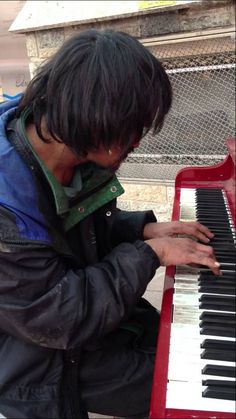 Ryan, a man who has been living on the street for 30 years plays the piano outside in downtown Edmonton, in Churchill Square, no one taught him to play, he just could.