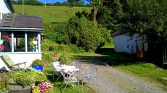Mill Stream Cottage, South West Wales. We have a swing in a tree and some outdoor games available. You can hang a badminton net in the back garden or a hammock by the lake http://www.organicholidays.com/at/3326.htm