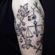 black justice tattoo
